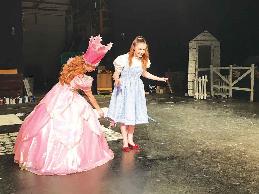 "Submitted Photo Chanda Parkinson, left, portrays ""Glinda"" while Maren Livingston plays ""Dorothy"" in the Minot State Summer Theatre production of the ""Wizard of Oz,"" starting Tuesday and playing through July 3 at the MSU Amphitheater."