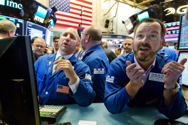 Specialists John Parisi, left, and Charles Boeddinghaus work on the floor of the New York Stock Exchange, Friday, June 23, 2017. U.S. stock indexes inched higher Friday as energy companies clawed back some of their sharp losses from earlier in the week. (AP Photo/Richard Drew)