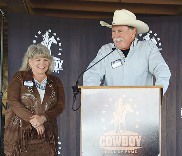 David Parker of Denton, Texas, talks about his great-grandfather, Clarence Parker of Minot, during the North Dakota Cowboy Hall of Fame's induction ceremony in Medora Saturday. Clarence Parker was inducted in the Hall of Fame in the Great Westerner category. At left is David Parker's wife Susan Parker.