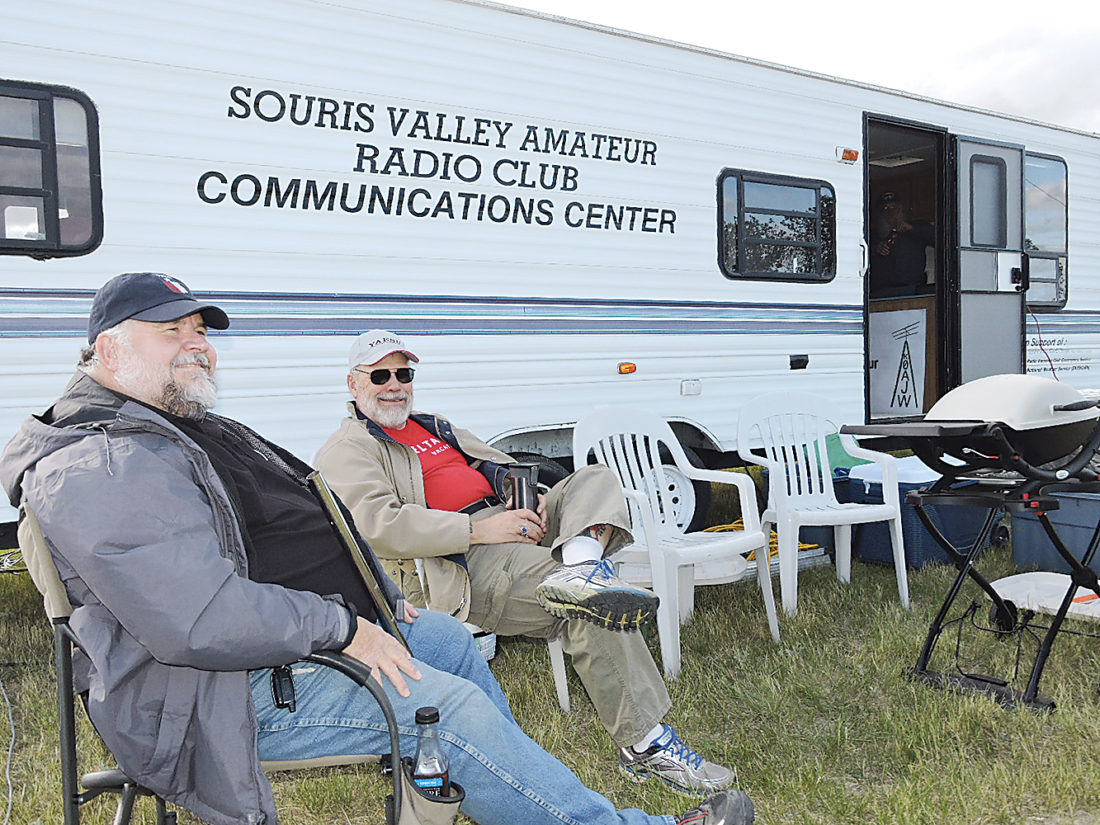 "Kim Fundingsland/MDN Doug ""W7MEX"" Shearer, left, and John ""AB0KZ"" Kinkade, both from Minot, were among members of the Souris Valley Amateur Radio Club who participated in an emergency preparedness exercise on Minot's North Hill Saturday."