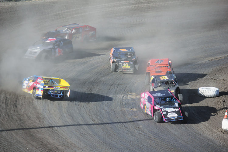 Alex Eisen/MDN Justin Bieber (5) from Fairview, Montana, loses control in turn No. 4 of an IMCA Modifieds heat race on Sunday at Nodak Speedway.