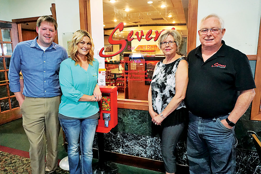 Jill Schramm/MDN Ryan Murphy and Jessica Anderson, left, and Denise and Steve Murphy, right, stand outside Sevens, the latest restaurant in the family's years in the Minot food industry.