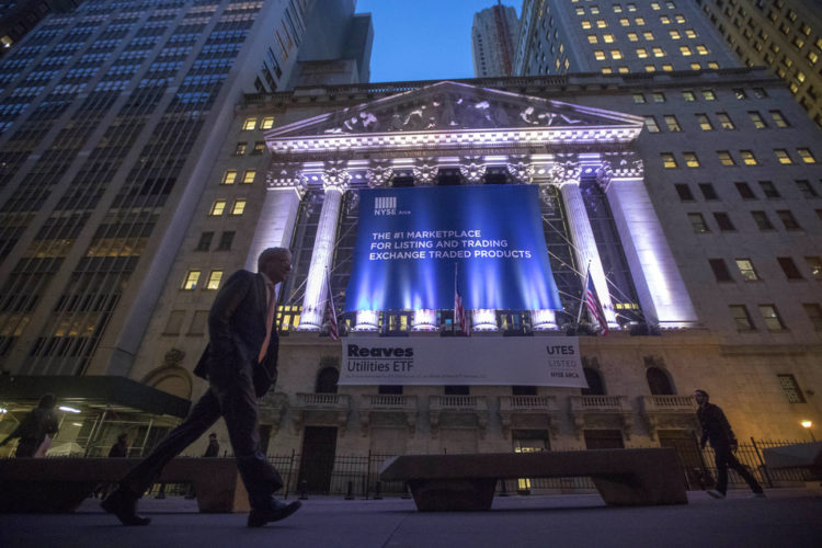 FILE - In this Tuesday, Oct. 25, 2016, file photo, a pedestrian walks past the New York Stock Exchange, in lower Manhattan. Technology and consumer-focused companies are leading stocks higher in early trading on Wall Street, Monday, June 26, 2017. (AP Photo/Mary Altaffer, File)