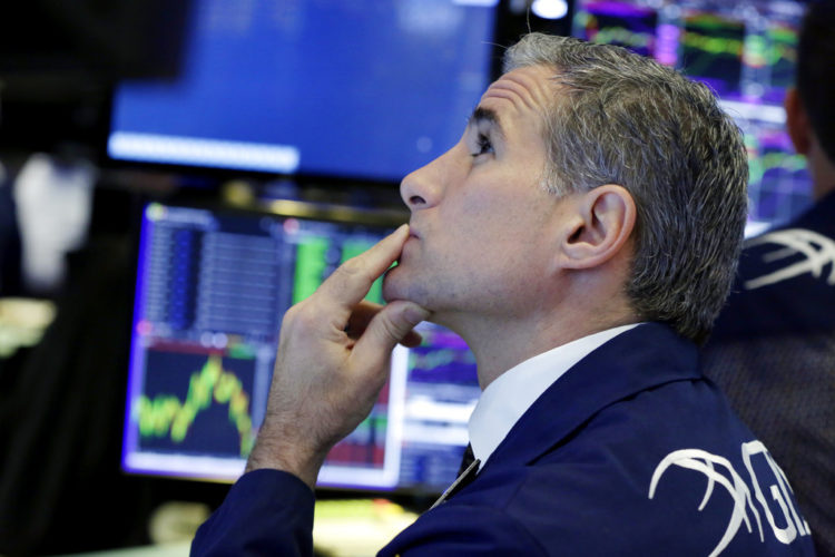 Specialist Anthony Rinaldi works at his post on the floor of the New York Stock Exchange, Tuesday, June 27, 2017. Stocks are opening slightly lower on Wall Street, led by declines in phone and technology companies. (AP Photo/Richard Drew)