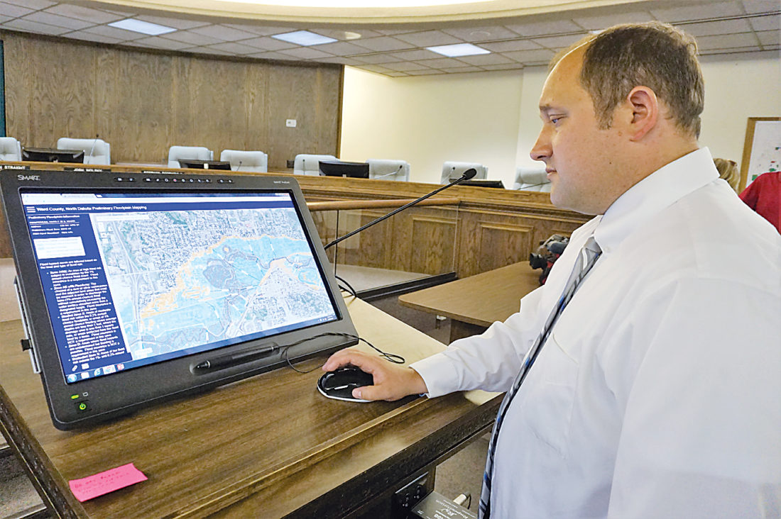Jill Schramm/MDN City Engineer Lance Meyer brings up FEMA's preliminary flood map on a computer screen in City Hall Wednesday.