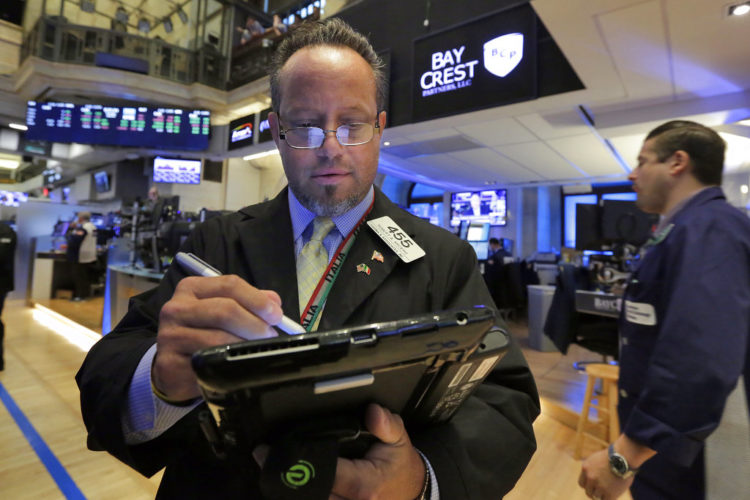 Trader Robert Arciero works on the floor of the New York Stock Exchange, Thursday, June 29, 2017. U.S. stock indexes moved lower in early trading Thursday, giving up some of their gains from the day before. (AP Photo/Richard Drew)