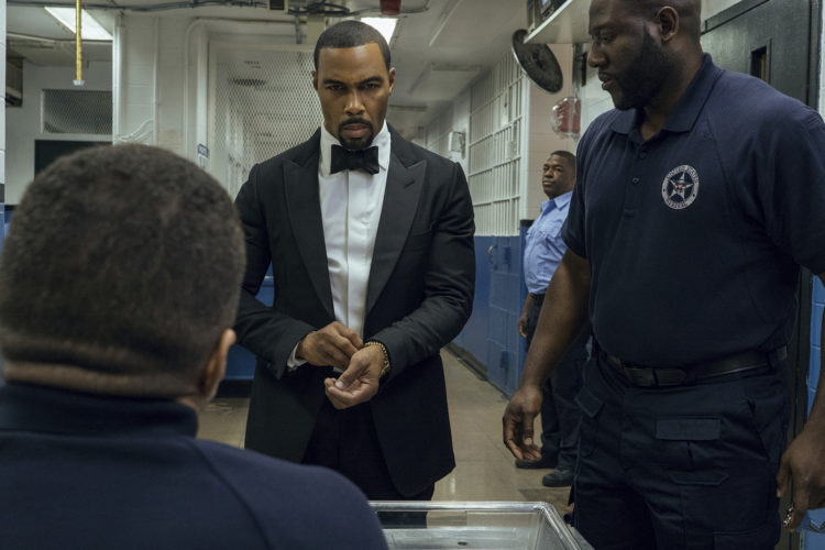 "This image released by Starz shows Omari Hardwick, center, in a scene from the original series, ""Power,"" returning for a new season on Sunday. (Myles Aronowitz/Starz via AP)"