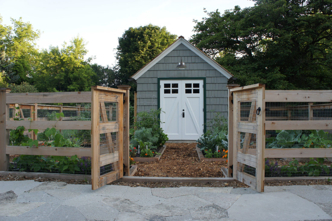 This 2015 photo provided by The Organic Gardener shows a garden around a shed in Lake Forest, Ill. (Heather Blackmore/The Organic Gardener via AP)