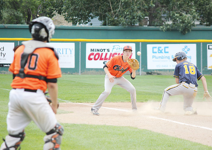 Alex Eisen/MDN Minot Vistas' Easton Bennett (18) slides into third base ahead of the throw on #Friday against Winnipeg South in the Vistas' first game of the Heilman's Performance Invitational at Corbett Field.