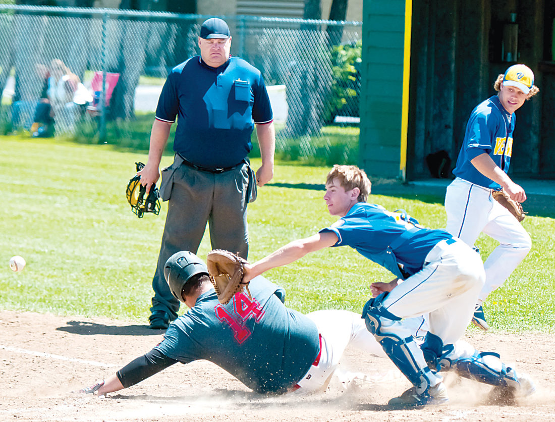 Bottineau Post 42 third baseman Noah McCloud slides safely home for a run during Bottineau's 14-4 five-inning home victory on Saturday.   Photo courtesy of Matthew Semisch/Bottineau Courant.