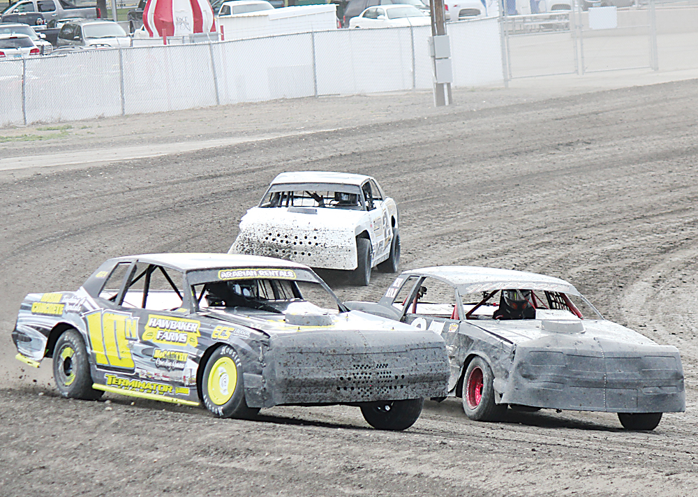 Alex Eisen/MDN Cody Nelson (10N) from Kenmare beats out Eric Harpole, Bismarck, in the first IMCA Stock Cars heat race on Sunday at Nodak Speedway.