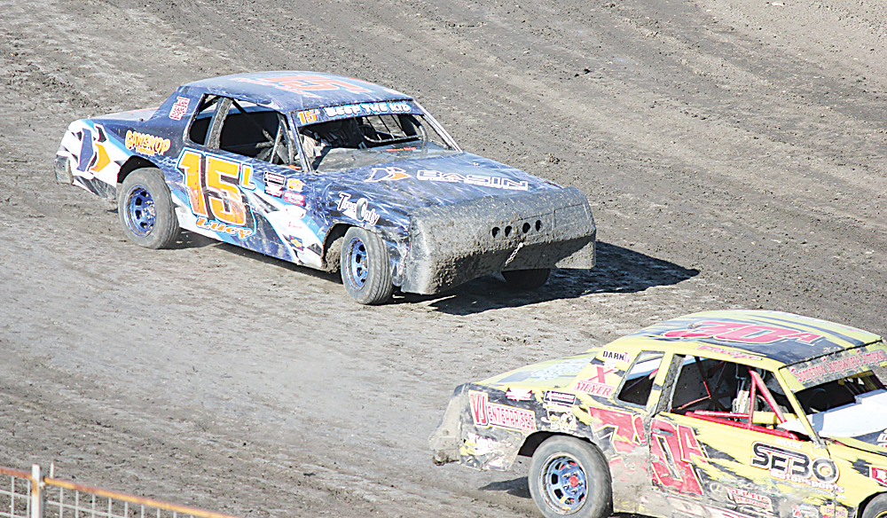 Alex Eisen/MDN Tyler Lucy (15) exits turn four in an IMCA Hobby Stocks heat race Tuesday at Nodak Speedway.