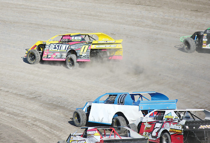 Alex Eisen/MDN Robby Rosselli (0) leads a pack of IMCA Sport Mods in his heat race Tuesday evening at Nodak Speedway.