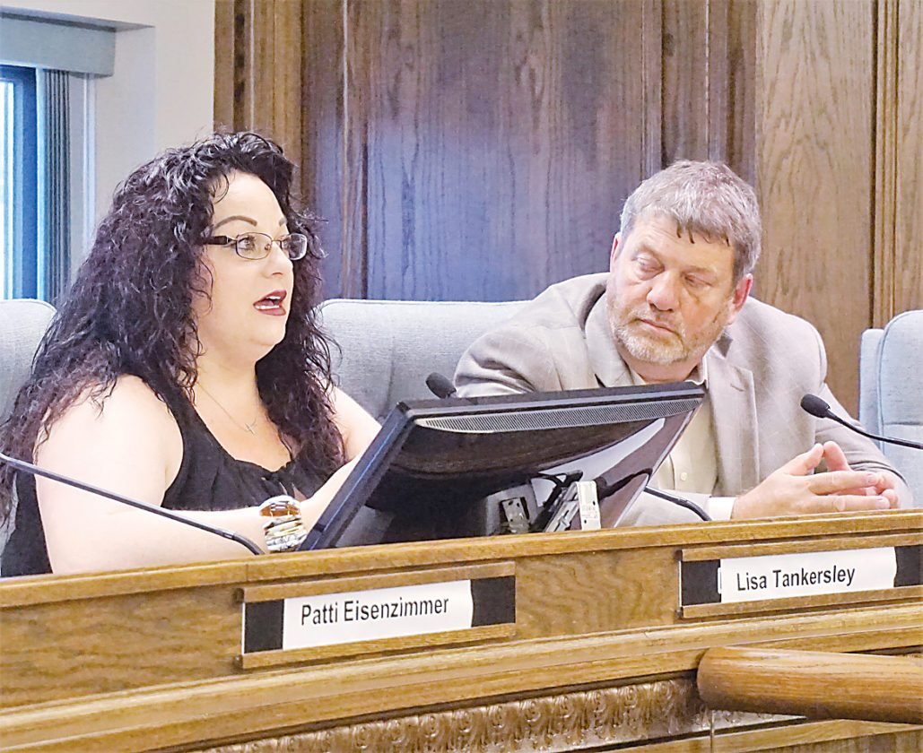 Jill Schramm/MDN Lisa Tankersley, left, speaks as Supt. Mark Vollmer listens during the Committee on Addiction meeting Wednesday in City Hall.