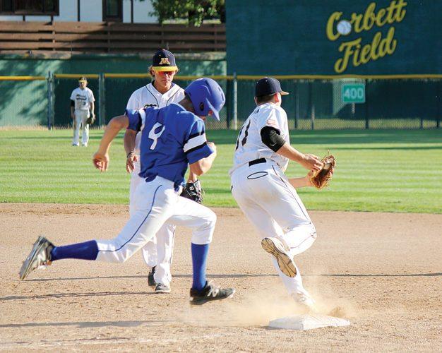 Alex Eisen/MDN After getting a toss from first baseman Lofton Klabunde, Vistas pitcher Eli Stewart (11) completes the out against the Jamestown runner on Friday in an American Legion baseball game at Corbett Field.