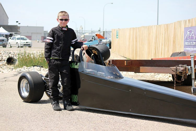 Alex Eisen/MDN Tristan Tidwell, 10, from Stanley stands next to his junior dragster on Saturday at the Magic City International Dragway.