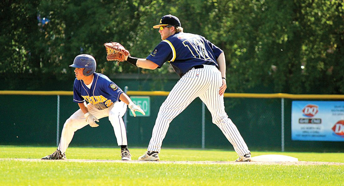 Alex Eisen/MDN Metros Jacob Widdel (17) holds on a Velva runner Monday in the first game of a doubleheader at Corbett Field.  The Metros won game one 11-5 and game two 20-2.