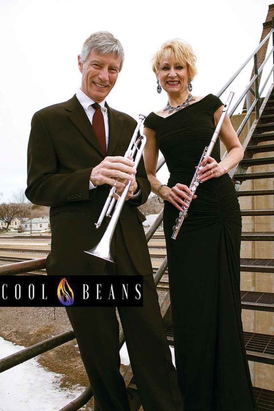 "Trumpeter, arranger and vocalist Steve Veikley stands beside flutist and vocalist Terri Aldrich. Veikley and Aldrich make up the jazz duo known as Cool Beans, who will perform at Oak Park during the Minot Area Council of the Arts, ""Arts in the Parks, 2017 Free Summer Concerts."" Showtime starts at 7 p.m.  Submitted Photo"