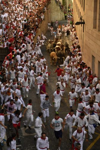 Revelers run in front of Cebada Gago fighting bulls during the first running of the bulls at the San Fermin Festival, in Pamplona, northern Spain, Friday, July 7, 2017. (AP Photo/Alvaro Barrientos)