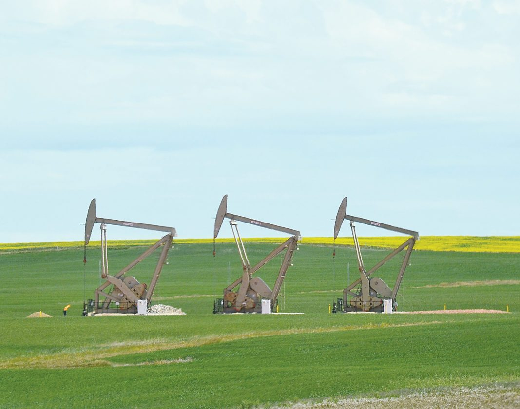 Eloise Ogden/MDN Pumping units are shown in the Medora area June 25. North Dakota's oil production has dipped slightly but remains over 1 million barrels of oil a day.