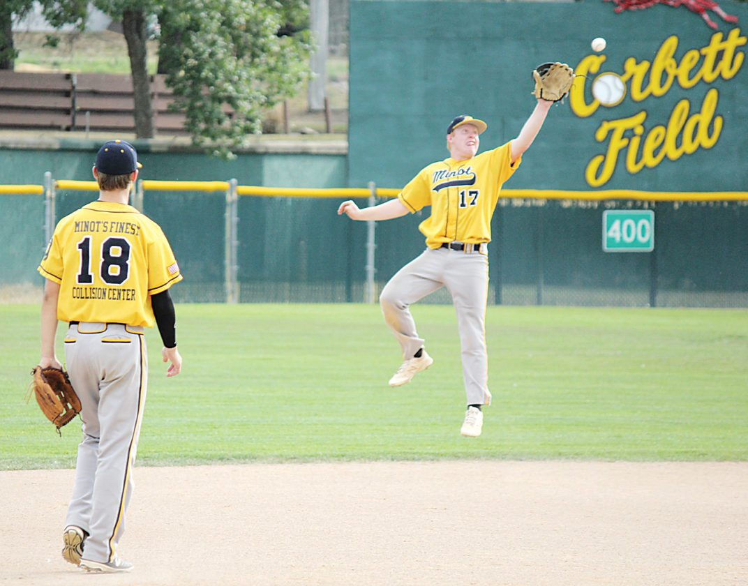 Alex Eisen/MDN Vistas' Conor Taney (17) makes a leaping catch with Easton Bennett (18) watching on in the first game against Williston on Friday at Corbett Field.