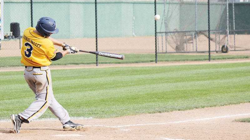 Alex Eisen/MDN Minot Vistas' Johnny Tubbs makes contact with a pitch in an American Legion baseball game against Williston on Friday at Corbett Field.