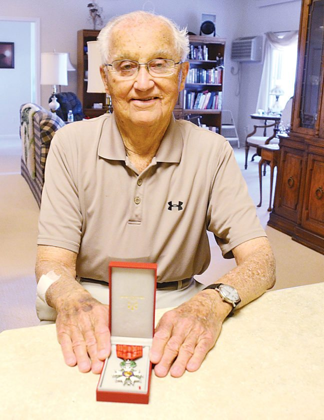 Eloise Ogden/MDN Lynn Aas, a World War II veteran from Minot, is shown with the Knight of the Legion Honor medal. The medal is France's highest honor and pays tribute to the soldiers who did so much for France and Western Europe 73 years ago.
