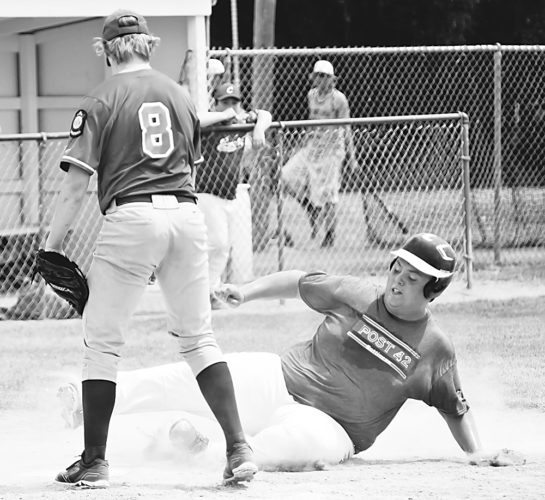 Matthew Semisch/Bottineau Courant Bottineau's Jarrett Lord slides safely home during Post 42's West Region tournament elimination game Thursday against Crosby in Lansford. A seven-run sixth inning helped Bottineau on the way to its 13-9 win.
