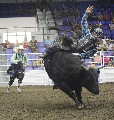 Alex Eisen/MDN In a photo taken at last year's NPRA Championship Bull Riding event at the North Dakota State Fair, Dylan Madsen of Presho, S.D., attempts to stay on his bull, but ultimately fails to do so.