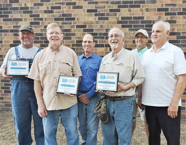 Kim Fundingsland/MDN Inducted into the North Dakota Fishing Hall of Fame during a July 14 ceremony in Garrison was, from the left, Clayton Folden, New Town; Paul Haug, Fargo; Richard Fink, Bismarck and the Lake Region Anglers of Devils Lake represented by Bob Gibson, Jay Hagen and Dave Magnuson.