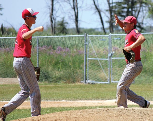 Alex Eisen/MDN Burlington's Noah Zietz (right) and Jarrett Vendsel (left) prepare to exchange a high five after beating Hazen 3-1 for the Class B West Region title on Sunday in Lansford.