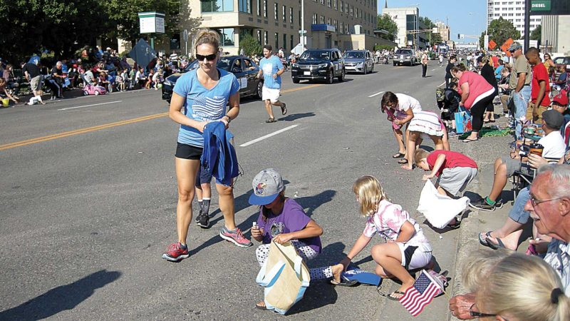 Andrea Johnson/MDN People hand out candy to kids during the North Dakota State Fair Parade on Saturday.