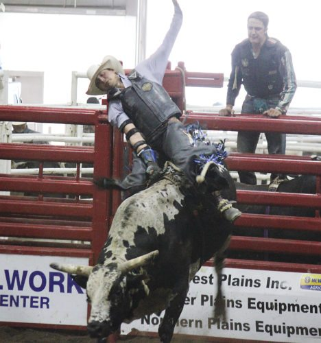 Alex Eisen/MDN Jake Benson from Dunn Center, tries,  but fails to stay on his bull during the NPRA Bull Riding competition Monday at the State Fair.