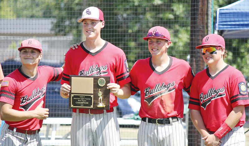 Alex Eisen/MDN Burlington players Noah Zietz, Jarrett Vendsel, Arron Grandy and John Koronka (left to right) pose for a picture with the American Legion Baseball Class B West Region championship plaque on Sunday in Lansford.