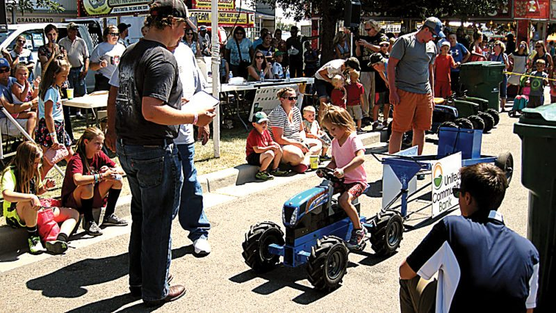 Andrea Johnson/MDN Paislee Lozensky, 4, daughter of Deanna and Kelly Lozensky of the South Prairie area, competes in the Kids' Pedal Pull on Tuesday afternoon at the North Dakota State Fair.