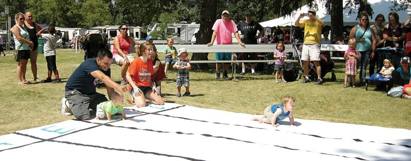 Andrea Johnson/MDN Isaiah Ramos, son of Anthony and Danielle Ramos of Minot, and Quade Mosley, son of Tara and Lloyd Mosley of Tioga, face off in the Diaper Derby at the North Dakota State Fair on Tuesday.