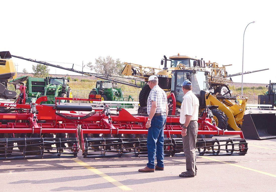 Eloise Ogden/MDN Farm machinery attracts many visitors at the North Dakota State Fair.