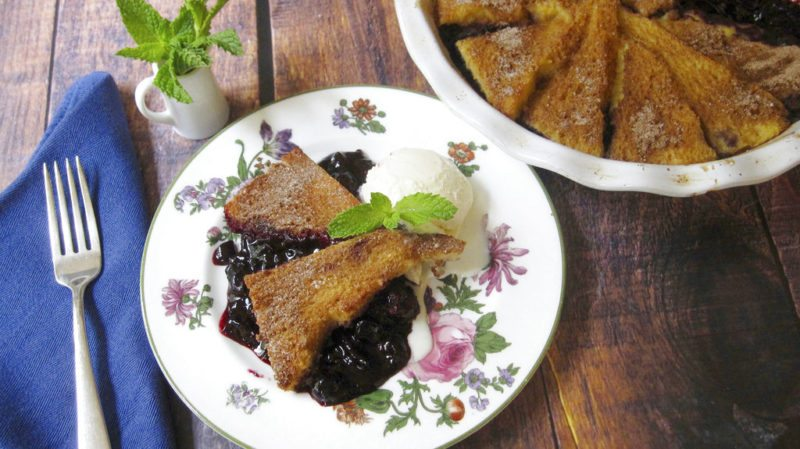This July 22, 2017 photo shows a blueberry pie with a cinnamon french toast crust in New York. This dish is from a recipe by Sara Moulton. (Sara Moulton via AP)
