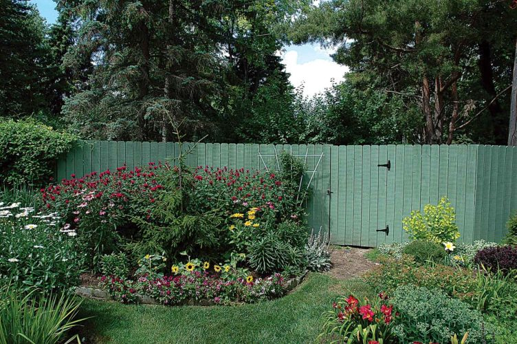 Submitted Photos MAIN: Decorative fences are an effective way to hide composting stations conveniently tucked behind gardens in the landscape, shown in this photo from Melinda Myers, LLC.