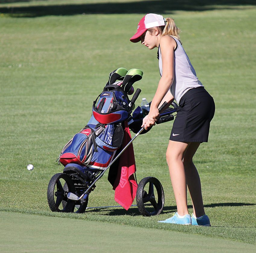 Alex Eisen/MDN Natalie Cook chips onto the green Thursday at the Vardon Golf Course in Minot.