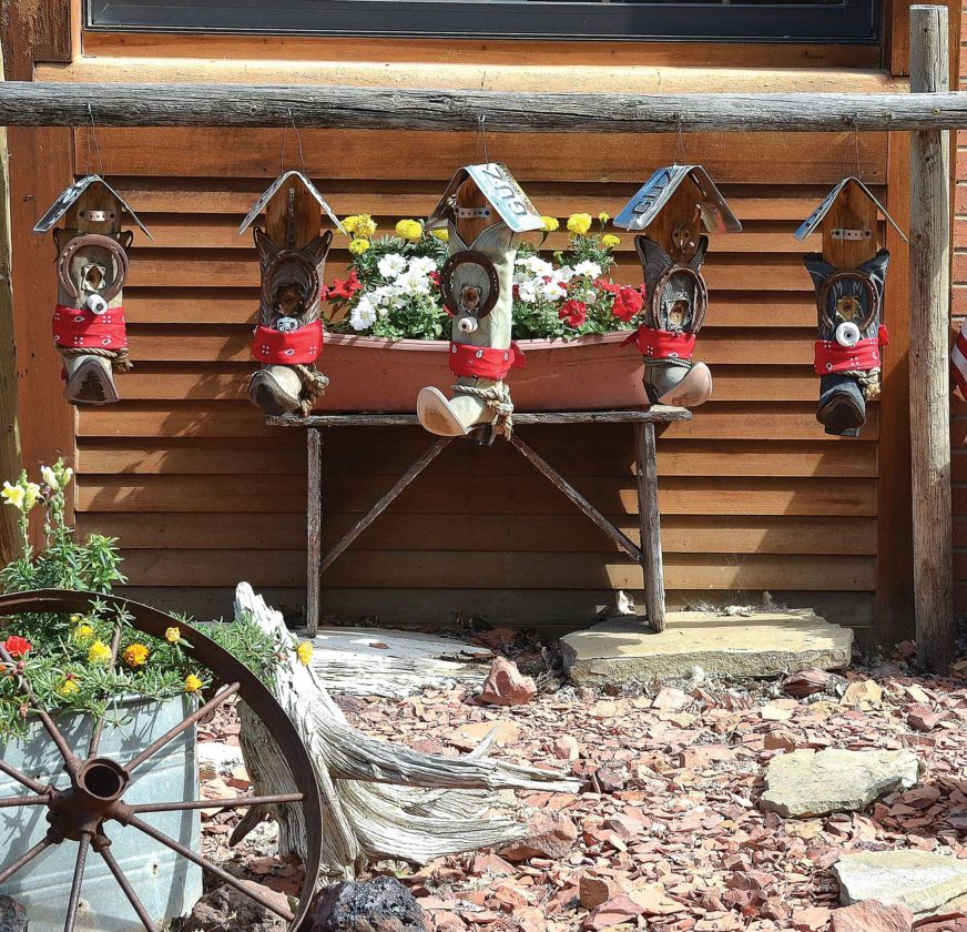 Old cowboy boots take a center stage in this landscape design in front of a business in Medora. The idea could be used for home landscaping as well.  Eloise Ogden/MDN