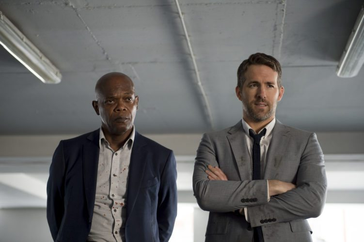 "This image released by Lionsgate shows Samuel L. Jackson, left, and Ryan Reynolds in ""The Hitman's Bodyguard."" (Jack English/Lionsgate via AP)"