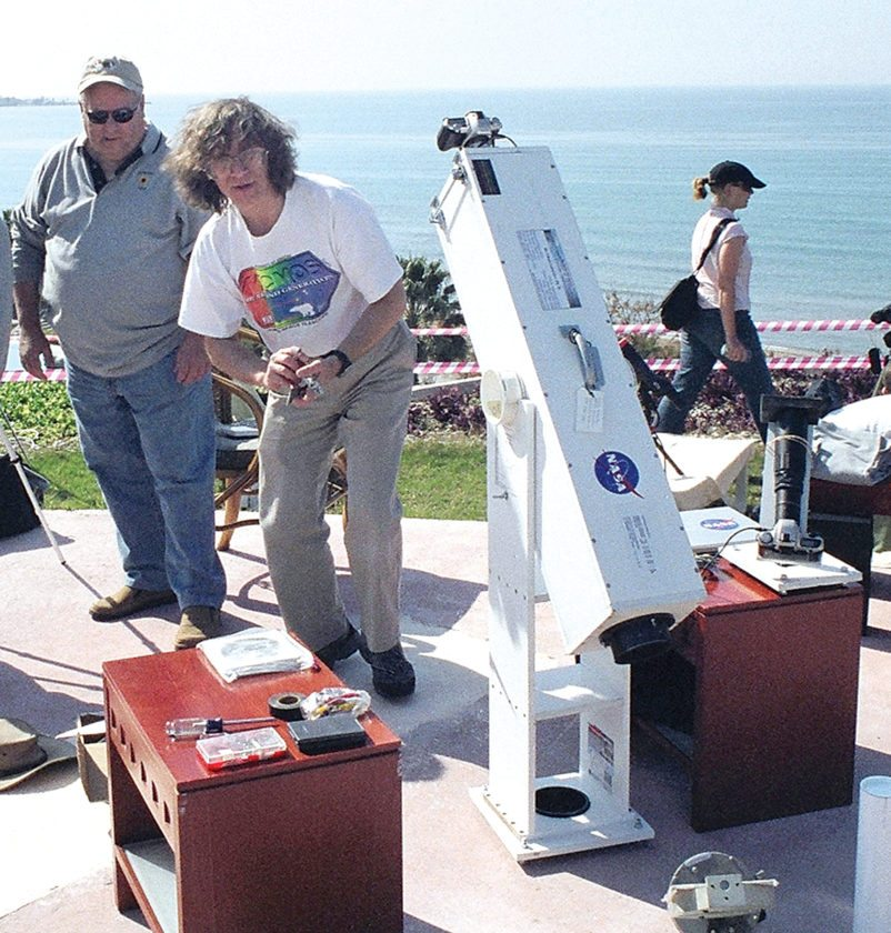 """APPhoto  This 2006 photo provided by Glenn Schneider shows him with his """"lug-o-scope"""" in Turkey. Schneider, was 14 in 1970 when he saw his first eclipse. """"I was frozen in place,"""" he recalled. """"I had binoculars around my neck for two and a half minutes and I never picked them up."""""""