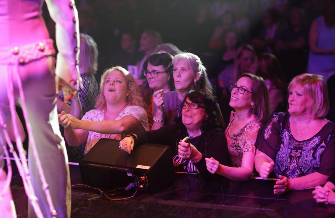 "In this July 15, 2017, photos, fans stand in front of the stage after a concert by professional Elvis tribute artists during the Images of the King: Las Vegas festival in Las Vegas. ""In my opinion they want to see an illusion of the man and his music,"" said Terri Futreal, a producer of the festival. (AP Photo/John Locher)"