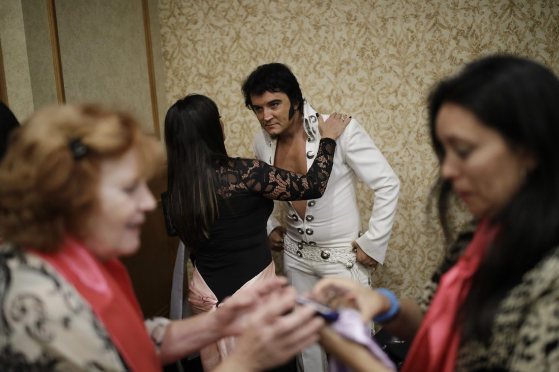 In this July 15, 2017, photo, Elvis tribute artist Ben Portsmouth meets with fans after a show in Las Vegas. Like other musical performers, tribute artists will meet with fans after the show and sell merchandise. (AP Photo/John Locher)