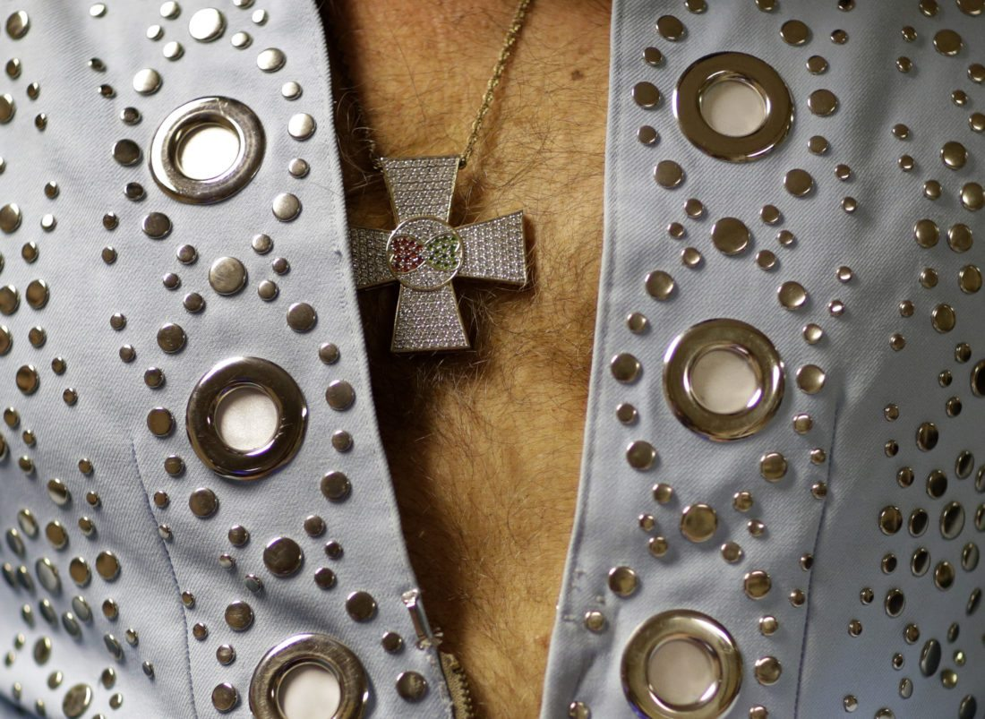 In this July 15, 2017 photo, Jim Westover of Arizona City, Ariz., waits backstage before performing at the Images of the King: Las Vegas tribute artist contest in Las Vegas. Tribute artists will buy custom made clothes and jewelry to recreate outfits worn by Elvis. (AP Photo/John Locher)