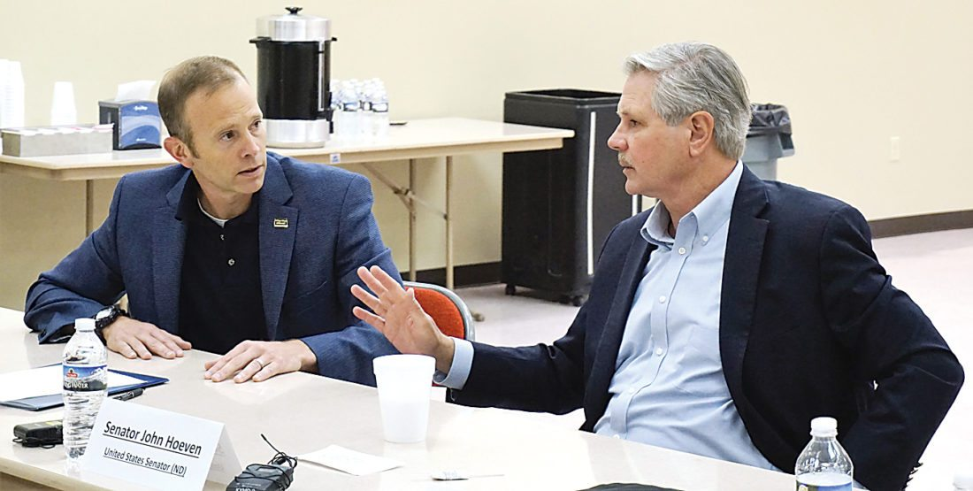 Jill Schramm/MDN Sen. John Hoeven, right, talks with Brock Long, administrator of the Federal Emergency Management Agency, at a forum in Minot Friday. Hoeven also visited Minot Air Force Base to tour the base and the new weapons firing range.
