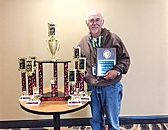 Submitted Photo Bruce Rosten holds awards earned at the Pyrotechnics Guild Association.
