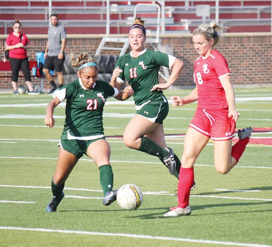 Alex Eisen/MDN Minot State senior defender Yesenia Piceno (21) pokes the ball away from junior forward Haley Berryman (18) in a scrimmage held Saturday at Herb Parker Stadium.