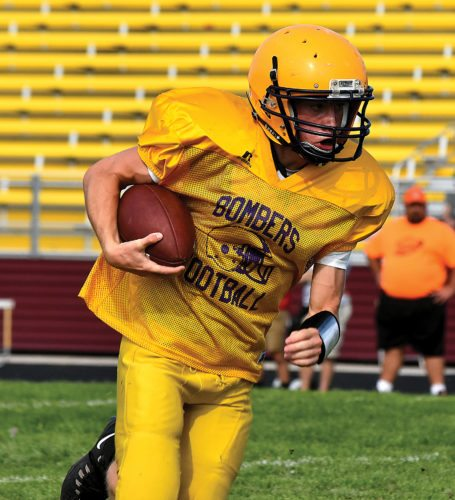 Garrick Hodge/MDN Senior quarterback Job Bachmeier runs with the ball in a scrimmage held last week at Minot High School.